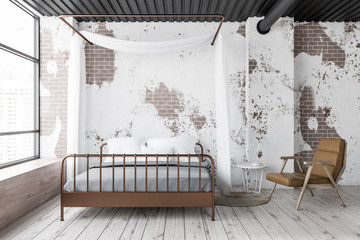 Grunge master bedroom with armchair