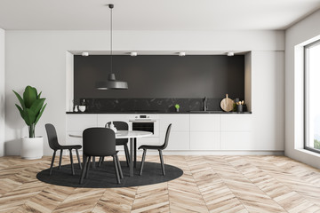 White and black kitchen with table