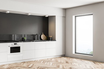 Black kitchen corner, white countertops