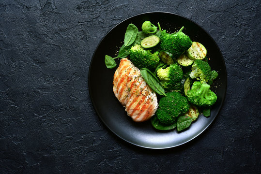 Grilled chicken fillet with green vegetable salad.Top view with copy space.