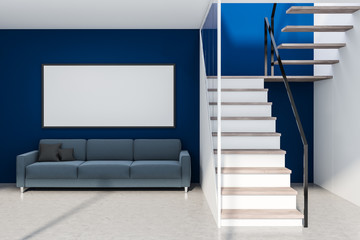 Blue living room with stairs and poster