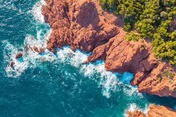 View of rocky coastline during sunny day