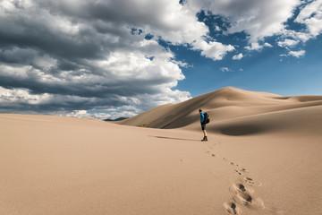 Man standing on desert at Great Sand Dunes National Park and Preserve Fotoväggar