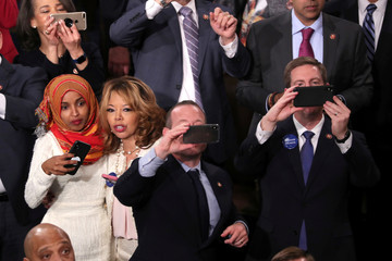 U.S. Representative-elect Ilhan Omar (D-MN) takes pictures of children at the U.S. Capitol in Washington