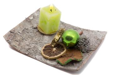 Handmade Christmas decoration with burning candle on white background