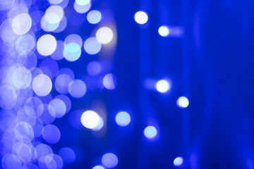 .Abstract bokeh on bright blue background