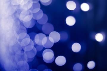 Bokeh on blue background, toned polaroid