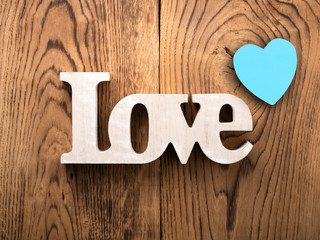 """word """"love"""" on wooden background"""