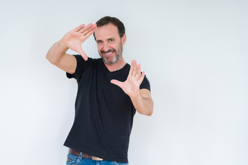 Senior man over isolated background Smiling doing frame using hands palms and fingers, camera perspective