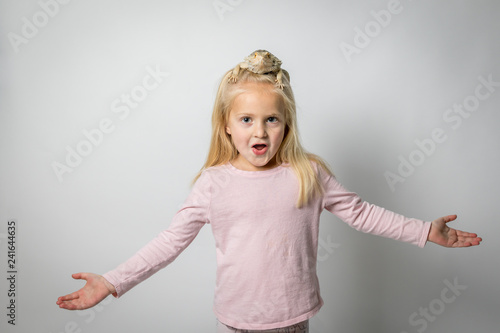 Cute Little Girl with Bearded Dragon Lizard on Head