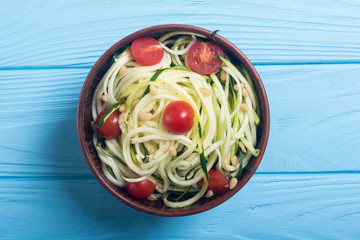 Zucchini pasta noodles with tomatoes . Healthy vegetarian food