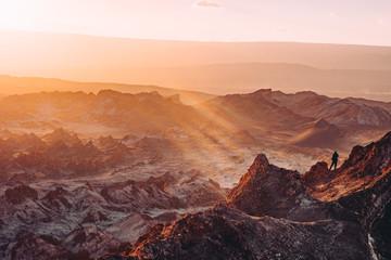 atacama desert hike peak sunset rays Chile