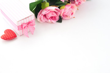 Pink roses, Gift box and heart on white background