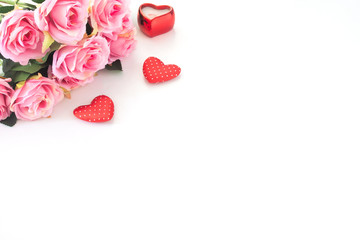 Pink roses and heart on white background