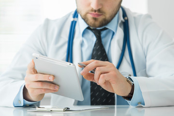 Close-up of doctor hand uses tablet