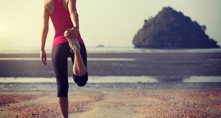Sports and stretching concept on summer beach