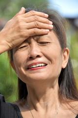 Older Filipina Adult Female And Stress