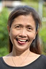 Older Filipina Grandmother Making Funny Faces