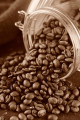 Coffee beans in glass jar. Toned photo