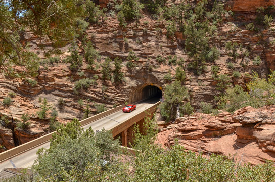 red car on the bridge over Pine Creek Gorge at the entrance of the Zion - Mount Carmel Tunnel in Zion National Park