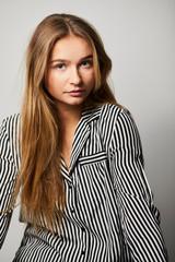 Pajama girl looking to camera, studio