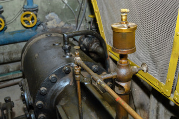 Oil bronze color filter with pipes for details of the water pump