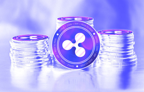 Ripple (XRP) digital crypto currency. Stack of coins. Cyber money.