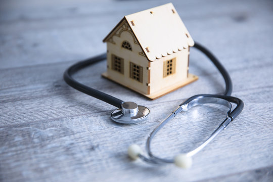 house model with stethoscope