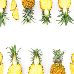 Tropical fruit frame. Sliced pineapple isolated on white background. Flat lay, top view.