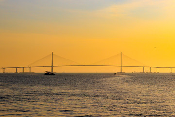 Scenery with Incheon Bridge and ship. Beautiful sea bridge. Incheon Bridge with sunset.