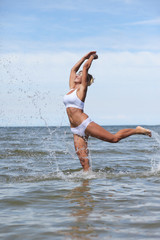 woman jumps out of the sea big splash