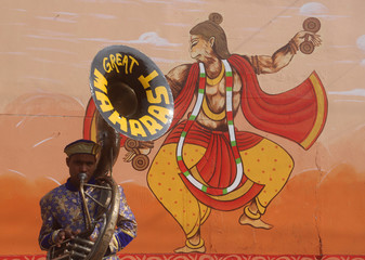 """A band member plays music during a religious procession ahead of the """"Kumbh Mela"""", or the Pitcher Festival, in Prayagraj"""