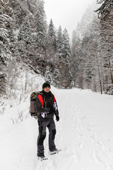 Backpacker in winter mountains