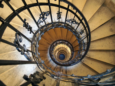 Spiral staircase in an old house with iron railings
