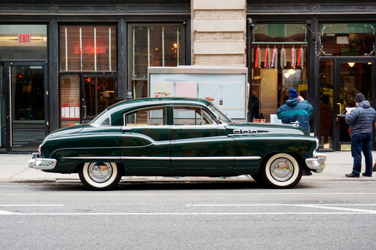 Side view of a classic vintage car in the street in NYC