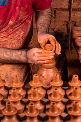Professional potter making bowl in pottery workshop, studio.