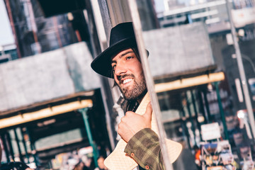 USA, New York City, portrait of bearded man with skateboard wearing black hat