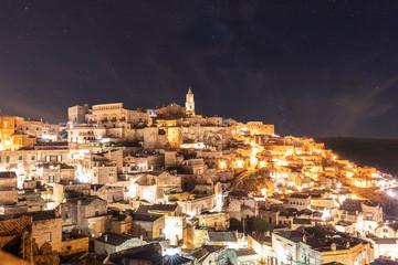 Italy, Basilicata, Matera, Townscape and historical cave dwelling, Sassi di Matera at night