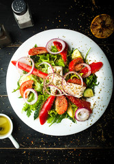 Delicious Greek salad of fresh vegetables on a plate