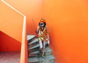 """A Naga Sadhu or Hindu holy man arrives to take part in a religious procession ahead of the """"Kumbh Mela"""", or the Pitcher Festival, in Prayagraj"""