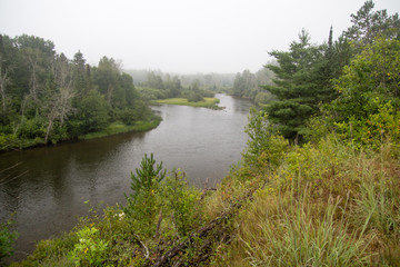 Wall Murals River Au Sable River. Fog in a river valley of the famous Au Sable River in the Lower Peninsula of Michigan. The river is the centerpiece of the Huron National Forest.