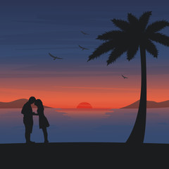 Couple are kissing on the beach with romantic sunset background