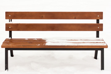 wooden bench in the Park under the snow