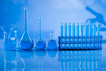 Laboratory beakers,Science experiment, blue background