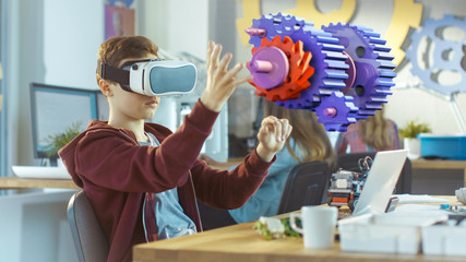In a Computer Science Class Boy Wearing Virtual Reality Headset Works in Interactive 3D Environment. Mechanical Modeling Project of Connecting Gears with Augmented Reality Software.
