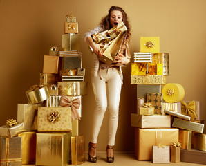 fashion-monger barely holding falling gifts and shopping bags