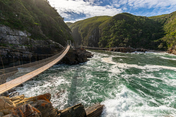 A suspension bridge over the storms river mouth in south africa Wall mural