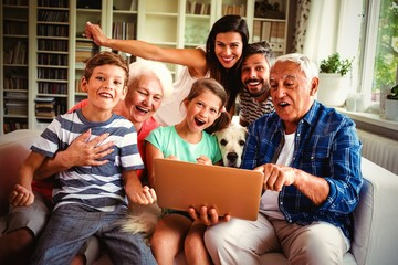 Portrait of happy multi generation using laptop Wall mural