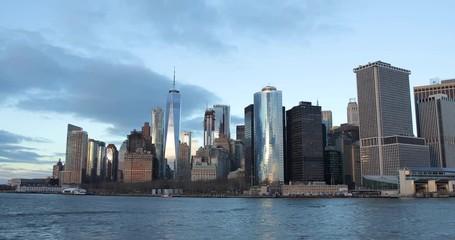 Fototapete - New York City downtown skyline buildings evening