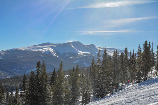 Snow covered rocky mountains surrounding the ski resort and valley in Breckenridge, Colorado.